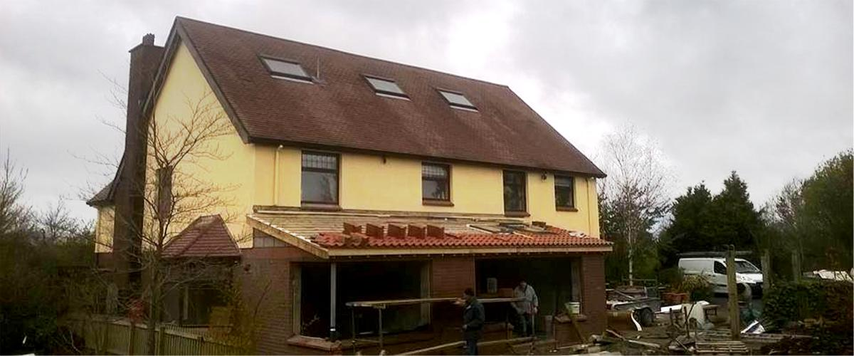 New roofing tiles being laid on an extension by Roof Repairs Belfast, Northern Ireland